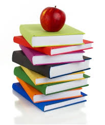Large stack of books with apple