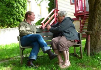 Dana and senior woman on a bench