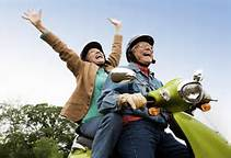 Senior couple on a scooter