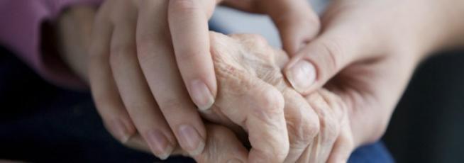 Holding a seniors hand
